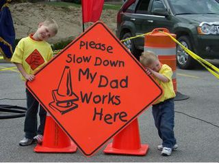 please slow down my dad works here work zone sign