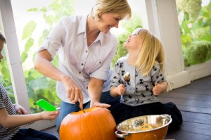 mom-and-kids-carving-pumpkin