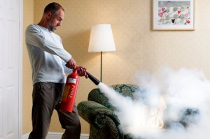 man-fire-extinguisher-home-chair-590kb072910