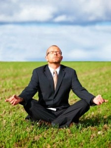 Zen meditation - Businessman doing zen